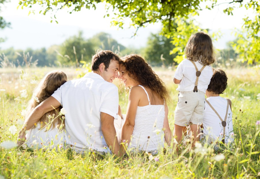 Happy family in the field with the kids, outdoor photography