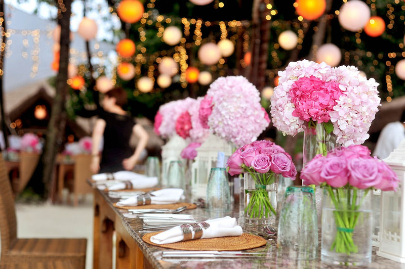 wedding Table With Plates and Flowers Filed Neatly Selective Focus Photography