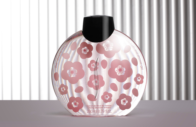 Clear Glass round Perfume Bottle on the striped background