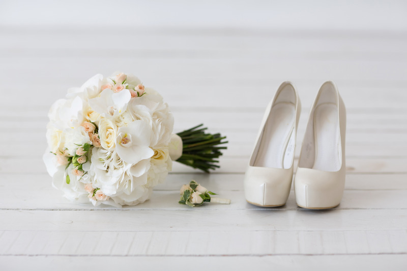 Wedding bouquet of white orchids and shoes