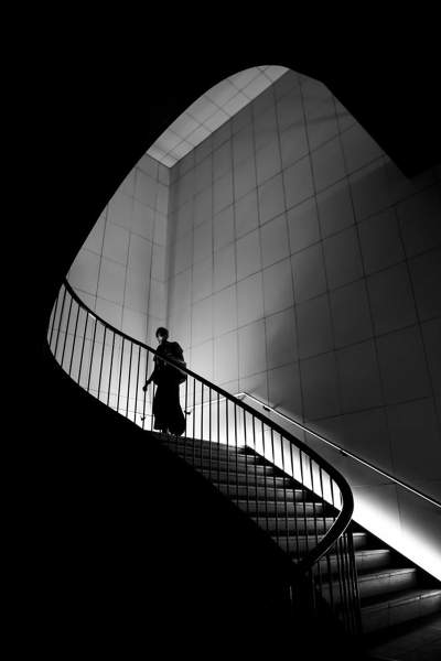 Black and white photography, person on the steps, shadows
